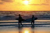 Surfers on sunset — Stock Photo