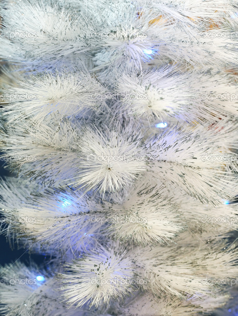Background of an artificial white fur-tree with fires  Stock Photo #6478870