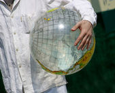 The globe in man's hands — Stock Photo