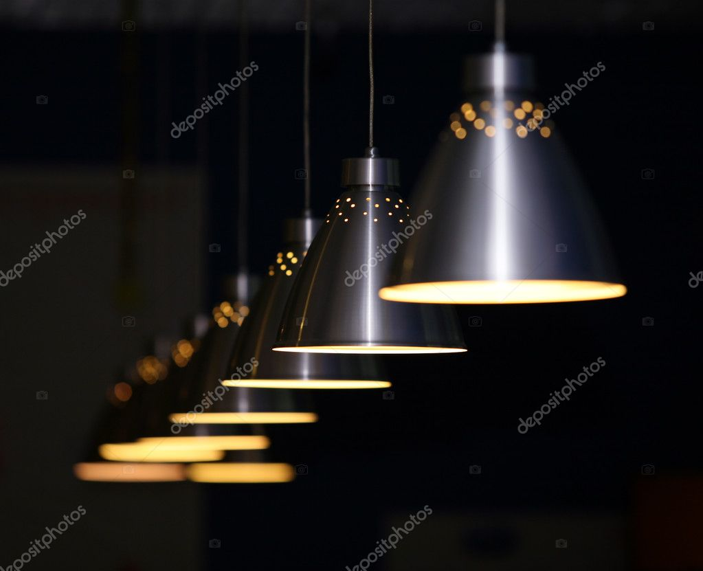 Many metal lamps at dark restaurant — Stock Photo #6482178