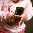 Child with the phone — Stock Photo