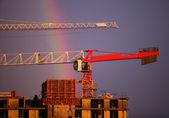 Construction crane and rainbow — Stock Photo