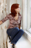 Gazing out window — Stock Photo