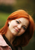 Girl with red hair — Stock Photo