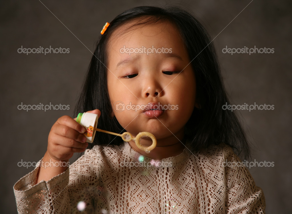 The small Korean girl and soap bubbles  Stock Photo #6613197