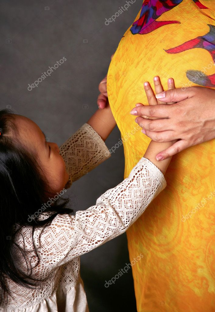 Mother and child anticipate the new baby — Stock Photo #6613218