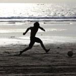 Football on a beach — Stock Photo