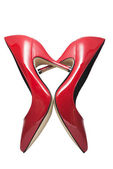 Red shoes forming a heart — Stock Photo