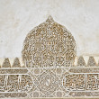 Decorative relief in the palace of the Alhambra — Stock Photo #6166251