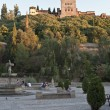 View of the Alhambra from the Paseo de los Tristes - Stock Photo