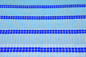 Tile stairs in the blue water of the pool — Stock Photo