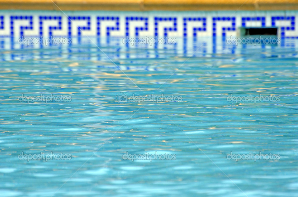 Blue water of the pool and mosaic border stock photo for Blue water parts piscine