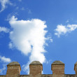 Stock Photo: Details of battlements of castle and sky