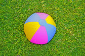 Beach ball in grass — Stock Photo
