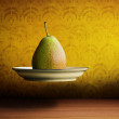 Stock Photo: Flying pear on plate