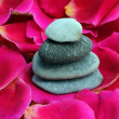 Stock Photo: Zen stones on rose petals
