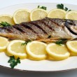 Stock Photo: Grill cooked fish with lemon slices