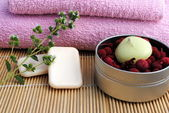 Candle and soap on bamboo background — Stock Photo
