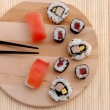 Sushi on wooden board with soy sauce and wasabi — Stock Photo