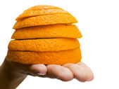 Slices of the orange on the hand — Stock Photo