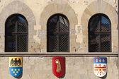 Medieval building in Arezzo (Tuscany, Italy): three windows — Stock Photo