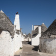 Royalty-Free Stock Photo: Alberobello (Bari, Puglia, Italy): Street in the trulli town