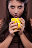 Woman with cup of beverage — Stock Photo