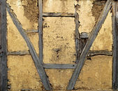Old wall of wooden construction with mud — Stock Photo