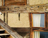 Old wall with old wooden window — Stock Photo