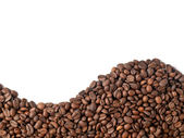 Wave of coffee beans on white — Stock Photo