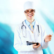 Smiling medical doctor with stethoscope on the hospitals backgro — Lizenzfreies Foto