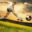 Foto Stock: Happiness football player on field of olimpic stadium on sunrise