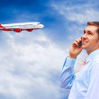 Businessman on the phone at an airport — Stock Photo