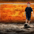 Football player and Grunge ball on the retro grunge background - Lizenzfreies Foto
