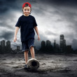 Royalty-Free Stock Photo: Football player and Grunge ball on the retro grunge background