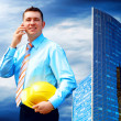 Stock Photo: Businessman on the Modern business architecture background