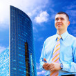 Businessman on the Modern business architecture background — Stock Photo #6351853