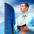 Businessman on the Modern business architecture background — Stock Photo #6351865