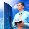 Businessman on the Modern business architecture background — Stockfoto