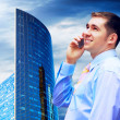 Businessman on the Modern business architecture background — Stock Photo