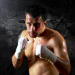Aggressive boxer with blood on the face — Stock Photo #6351899