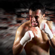 Stock Photo: Aggressive boxer with blood on the face