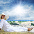 Young beautiful women in the white on the beach — Stock Photo