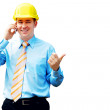 Young architect wearing a protective helmet standing on the buil — Stock Photo #6351924