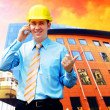 Young architect wearing a protective helmet standing on the buil — Stockfoto