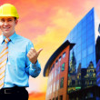 Young architect wearing a protective helmet standing on the buil — Stock Photo #6351929