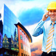 Young architect wearing a protective helmet standing on the buil — Stock Photo #6351931