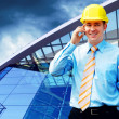 Young architect wearing a protective helmet standing on the buil — Foto de Stock