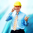 Young architect wearing a protective helmet standing on the buil — Stock Photo #6351943