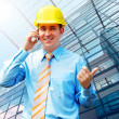 Stock Photo: Young architect wearing a protective helmet standing on the buil